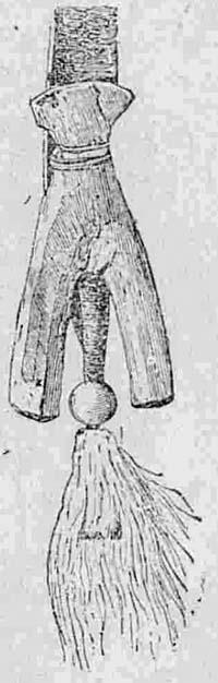 Деревянная фигура, представляющая защитника новорожденного